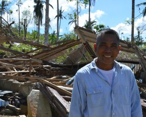 A Philippine pastor standing in front of his church destroyed Typhoon Haiyan